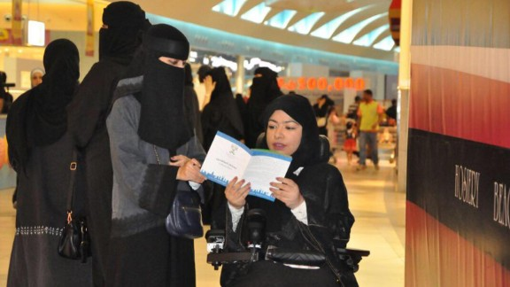 Women distribute leaflets to raise awareness among citizens to participate in the upcoming municipal elections on August 21 in Al Dammam, Saudi, Arabia.
