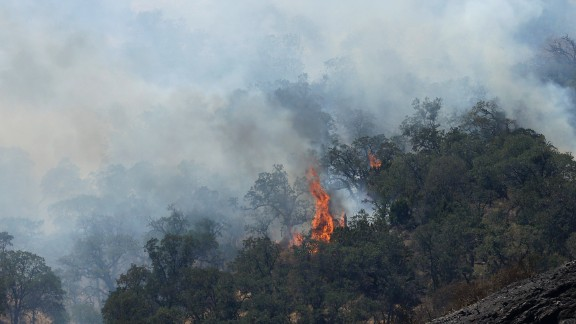 Fires burn on a hill in Livermore, California, on Thursday, August 20. California has been battling numerous wildfires as its historic drought reaches a fourth year.