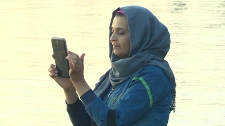 Migrants send home 'We're safe' selfies