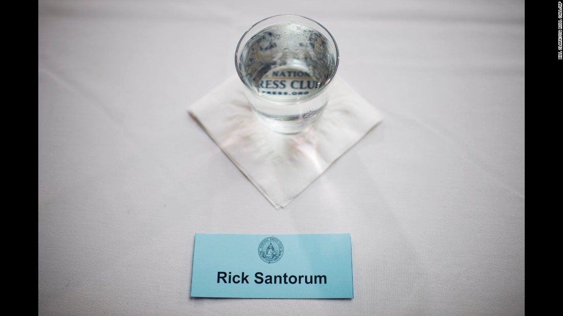 A card marks the seat of Republican presidential candidate Rick Santorum, who delivered a speech on immigration policy Thursday, August 20, at the National Press Club in Washington.