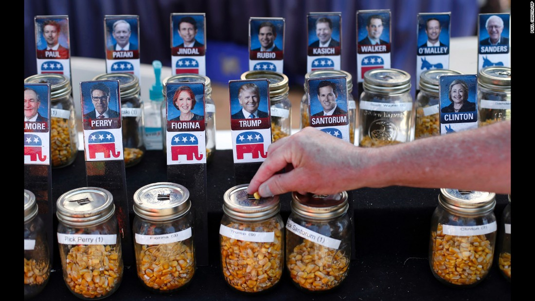 A visitor at the Iowa State Fair uses a corn kernel to vote in a straw poll on Thursday, August 20.