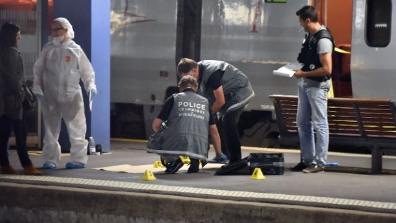 Police work on a platform next to a Thalys train of French national railway operator SNCF at the main train station in Arras, northern France, on August 21, 2015. A gunman opened fire on a train travelling from Amsterdam to Paris, injuring three people before being overpowered by passengers, French state rail company SNCF and rescue services said. Two of the victims were seriously injured and at least one suffered gunshot wounds, an SNCF spokesman said, adding that the assailant was armed with guns and knives. The motives behind the attack were not immediately known. AFP PHOTO / PHILIPPE HUGUEN        (Photo credit should read PHILIPPE HUGUEN/AFP/Getty Images)