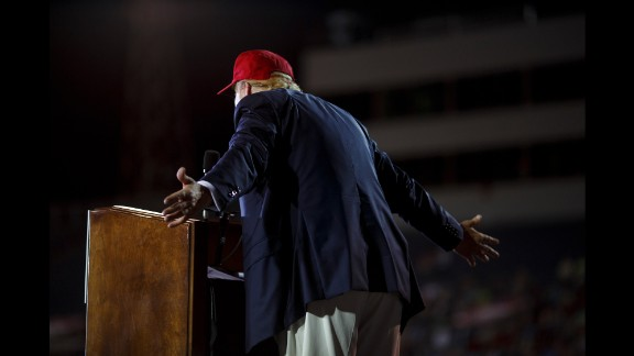 """At times appearing more prepared than usual -- referencing what seemed to be notes on his podium and relaying new statistics about illegal immigration to his crowd -- a joyful Trump offered to sign copies of his book, waved his arms to encourage applause at some of his one-liners and made an effort to his Southern crowd by calling the Bible his favorite book and lamenting the decline of the Alabama steel industry. """"I'd like to have the election tomorrow,"""" he said at one point. """"I don't want to wait."""""""