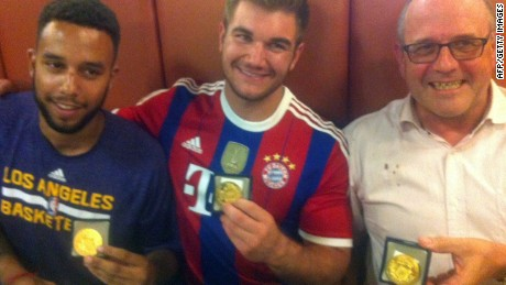 From left:  Anthony Sadler, from Pittsburg, California, Alek Skarlatos from Roseburg, Oregon, and British national Chris Norman -- who is living in France -- hold medals they received for stopping a gunman on a European train.