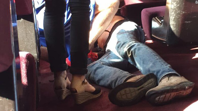 In this photo provided by Christina Cathleen Coons, a person lies on the floor after an incident on a high-speed train traveling from Amsterdam to Paris on Friday, Aug. 21, 2015. A gunman opened fire on the train wounding several people before American passengers subdued him, according to officials and one of the Americans involved. (Christina Cathleen Coon via AP)