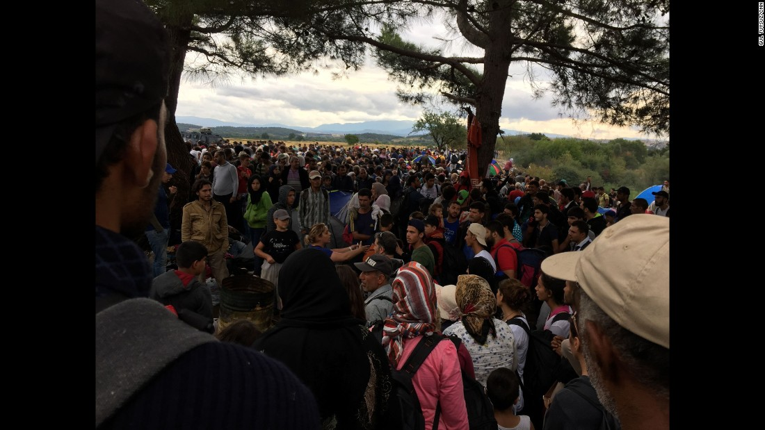 Migrants wait anxiously at the border. Macedonia has been allowing a trickle of migrants to enter into the country.