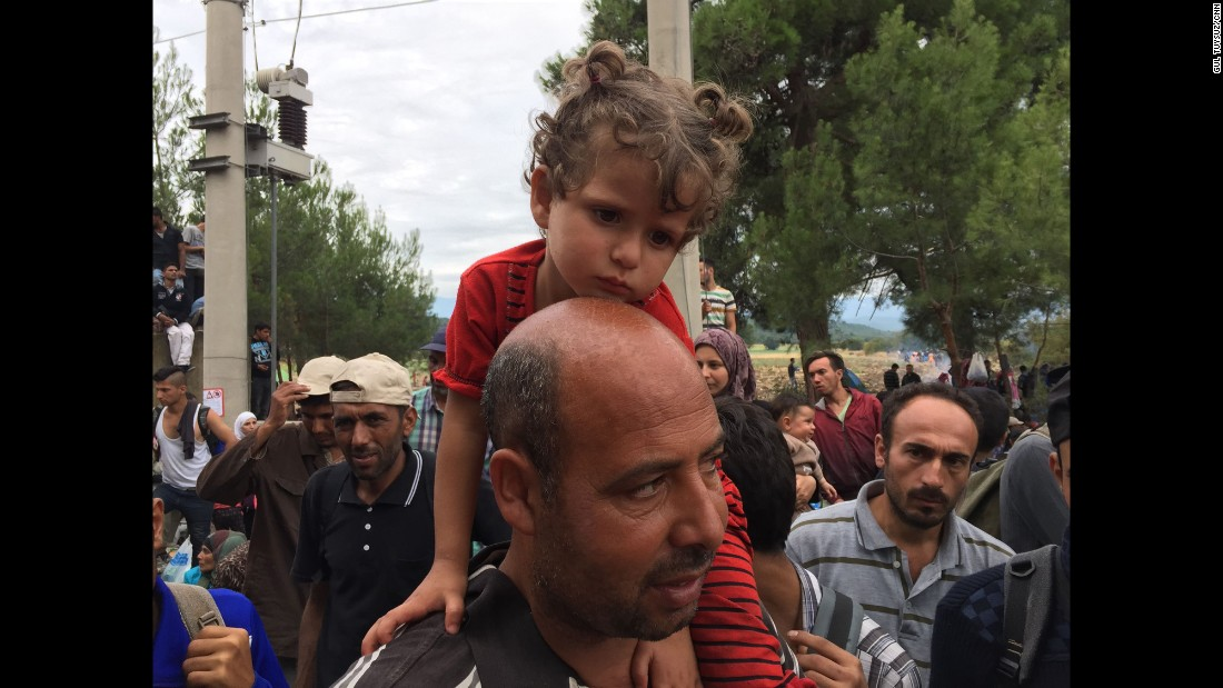 "Ibrahim Masri and his 3 year old daughter Bayan. ""We've been degraded, humiliated,"" Masri said. ""My daughter, in Syria, she was an angel. Now look at her. We are not animals."""