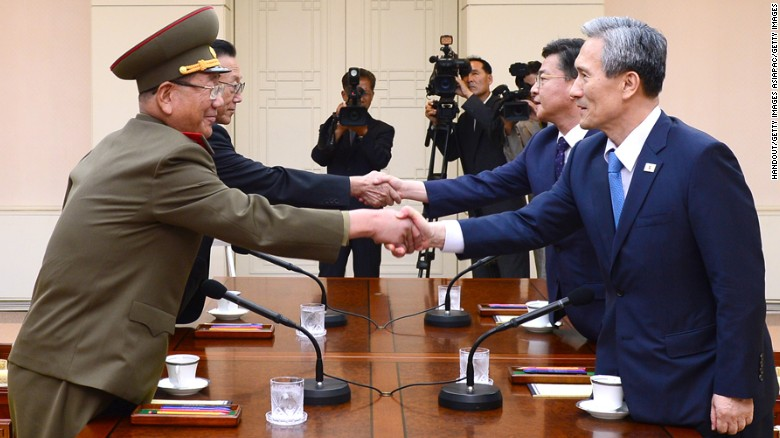 Korean talks resume as troop movements increase