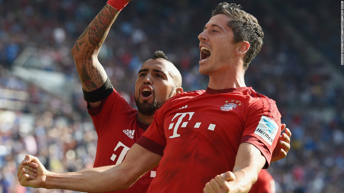 Substitute Robert Lewandowski (right) celebrates with Arturo Vidal after scoring Bayern Munich's late winner against Hoffenheim.