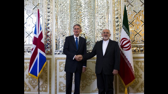 Iranian Foreign Minister Mohammad Javad Zarif (right) shakes hands with his British counterpart Philip Hammond prior to their joint press conference in Tehran on Sunday.