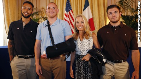 Off-duty US servicemen Anthony Sadler (L), Spencer Stone (2nd L), Alek Skarlatos (R) and US ambassador to France Jane Hartley (2nd R) pose after a press conference at the US embassy in Paris on August 23,  two days after 25-year-old Moroccan Ayoub El-Khazzani opened fire on a Thalys train travelling from Amsterdam to Paris, injuring two people before being tackled by several passengers including off-duty American servicemen.