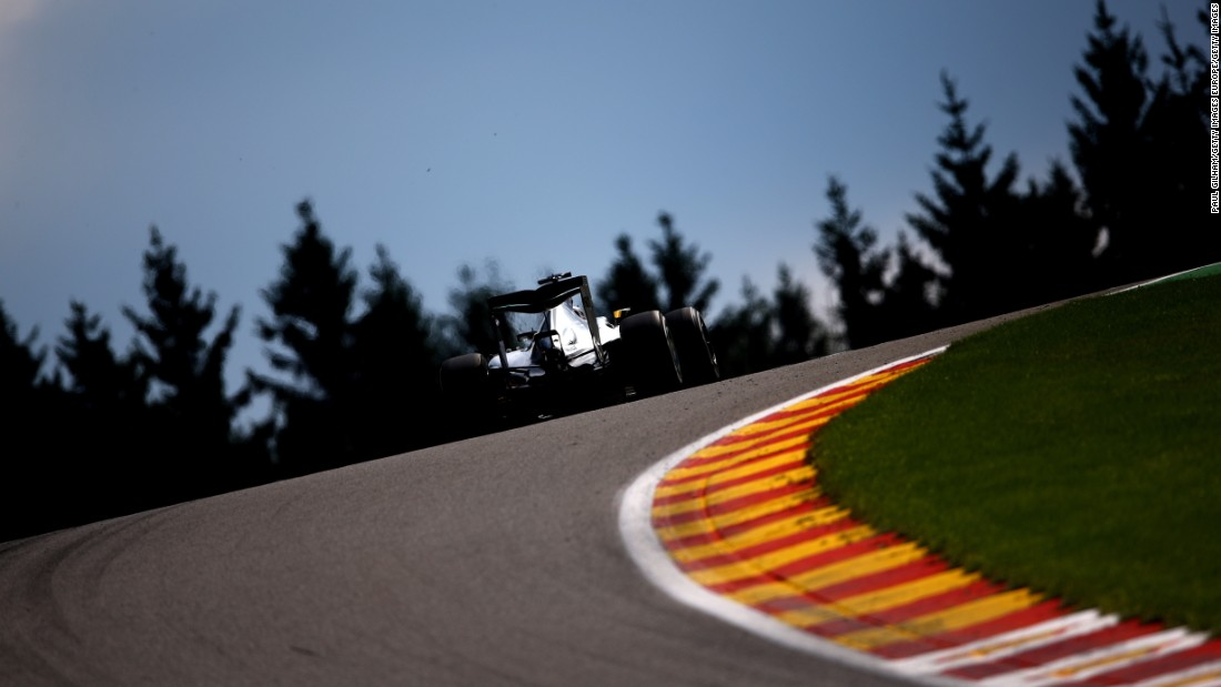 Hamilton driving at Spa amid the picturesque trees of the Ardennes Forest. The Briton's victory at the Belgium GP was  his sixth of 2015.