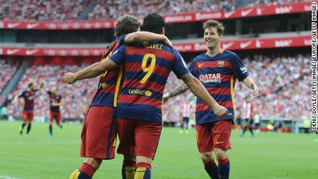 BILBAO, SPAIN - AUGUST 23:  Luis Suarez of FC Barcelona celebrates with Lionel Messi and Sergi Roberto after scoring Barcelona opening goal during the La Liga match between Athletic Club and FC Barcelona at San Mames Stadium on August 23, 2015 in Bilbao, Spain.  (Photo by Denis Doyle/Getty Images)