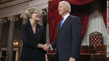 U.S. Sen. Elizabeth Warren (D-MA) (L) participates in a reenacted swearing-in with U.S. Vice President Joe Biden in the Old Senate Chamber at the U.S. Capitol  January 3, 2013 in Washington, DC. Biden swore in the newly-elected and re-elected senators earlier in the day on the floor of the current Senate chamber.