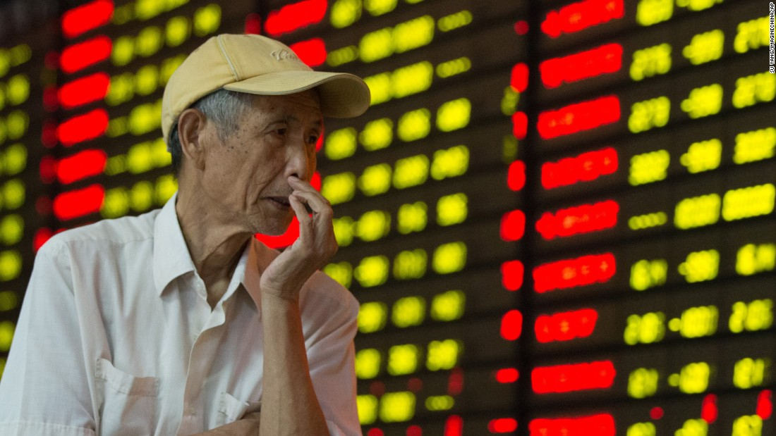 A  Chinese investor watches stock prices at a brokerage house in Nanjing, China, on Monday, August 24. Chinese stocks plunged Monday, continuing to fuel a global sell-off.