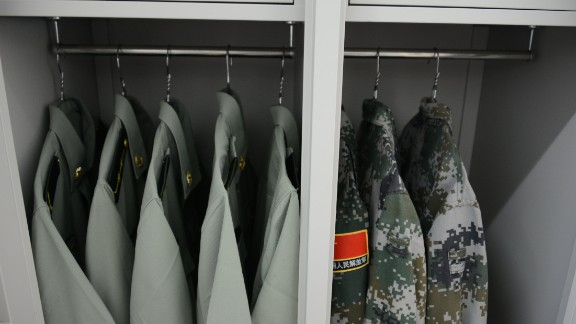 Soldiers' uniforms hang neatly in their dorm room closet on August 22.