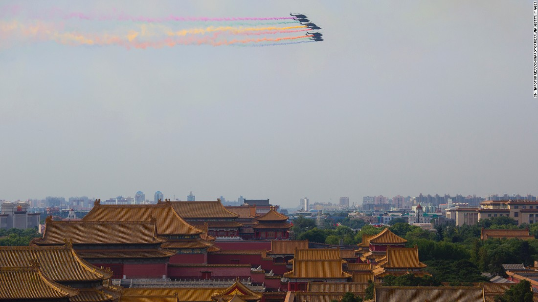 Chinese military helicopters fly over the Forbidden City in Beijing on August 23. Most of the armaments that will go on display during the parade won't have been seen by the public before, Xinhua reported.