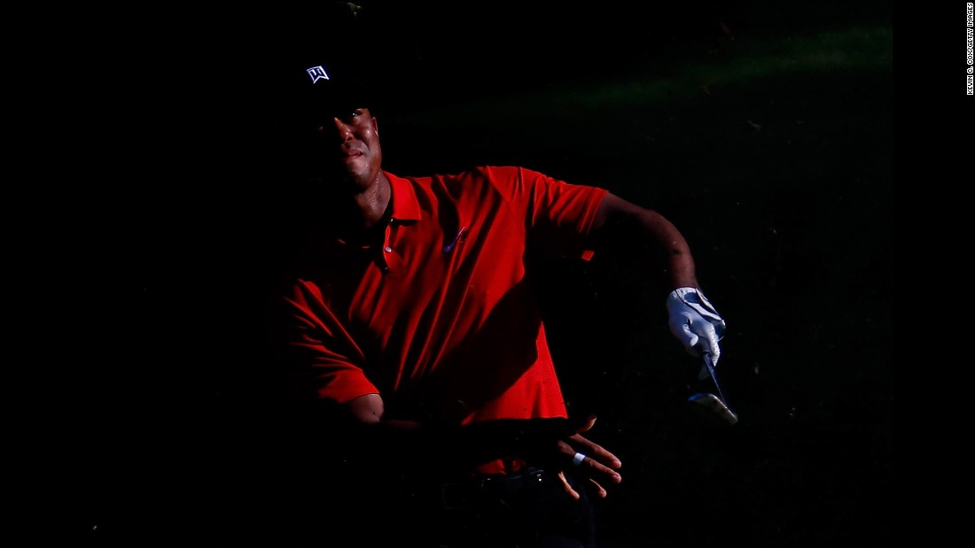"Tiger Woods plays a shot Sunday, August 23, during the final round of the Wyndham Championship in Greensboro, North Carolina. Woods finished the tournament tied for 10th, <a href=""http://www.cnn.com/2015/08/24/golf/tiger-woods-wyndham-final-round/index.html"" target=""_blank"">ending his season on the PGA Tour.</a> Woods needed to win the event to qualify for the FedEx Cup playoffs."