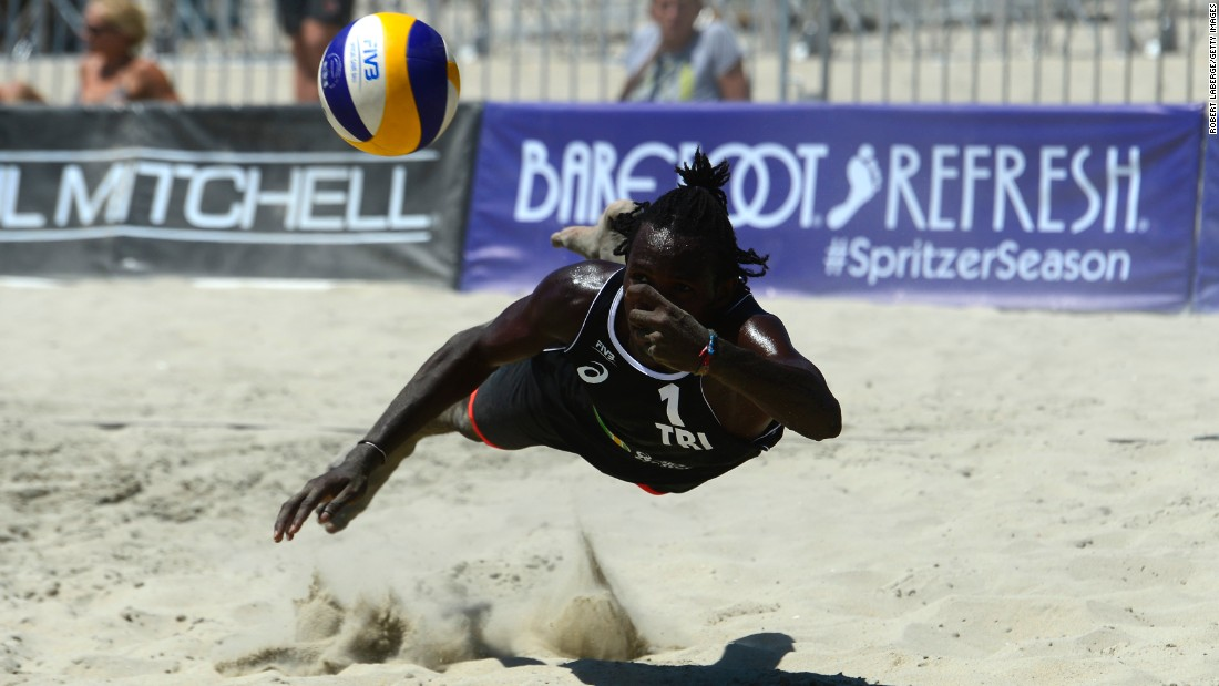 Trinidad's Fabien Whitfield digs the ball Tuesday, August 18, at the World Series of Beach Volleyball. The tournament was held in Long Beach, California.