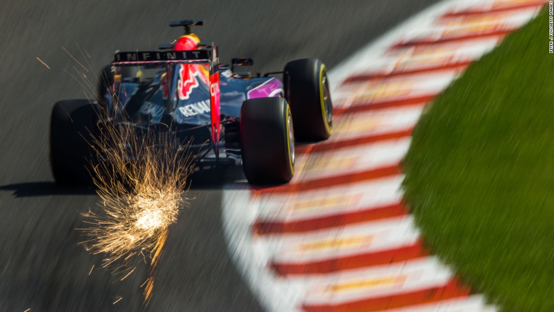 In this long-exposure photo, sparks fly from the car of Formula One driver Daniel Ricciardo as he practices for the Belgian Grand Prix on Saturday, August 22.