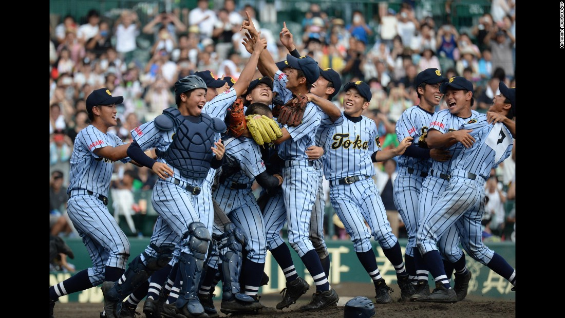 High school players from Tokaidai Sagami celebrate after winning the national championship Thursday, August 20, in Nishinomiya, Japan.