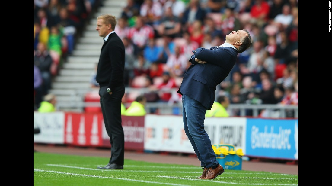 Sunderland manager Dick Advocaat, right, reacts during a Premier League match against Garry Monk's Swansea City on Saturday, August 22. The match in Sunderland, England, ended in a 1-1 draw.