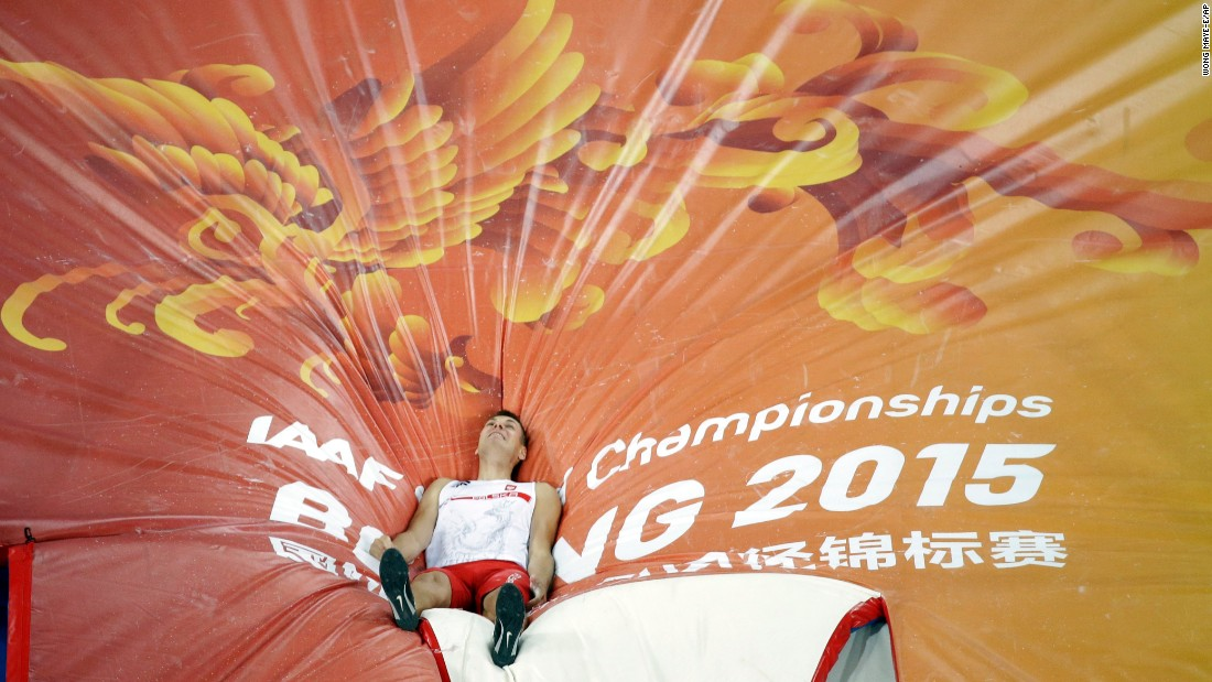 Poland's Pawel Wojciechowski lies on the mat after crashing out in the World Championships' pole-vault final on Monday, August 24. He finished in third place.