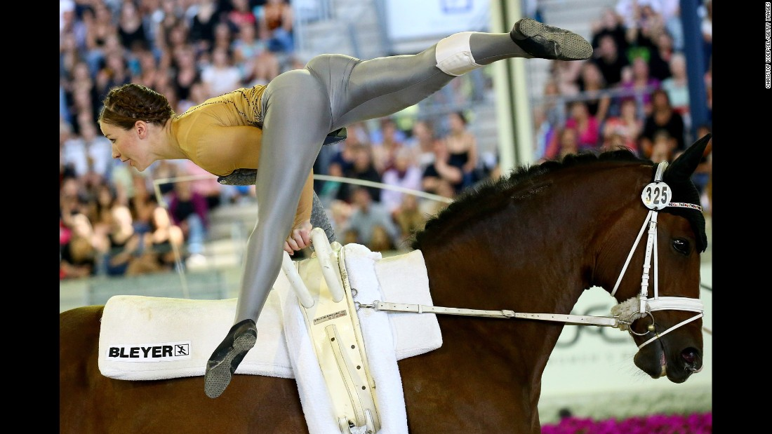Germany's Corinna Knauf performs on Fabiola during the vaulting final of the European Equestrian Championships. She won silver in the event, which finished Sunday, August 23, in Aachen, Germany.