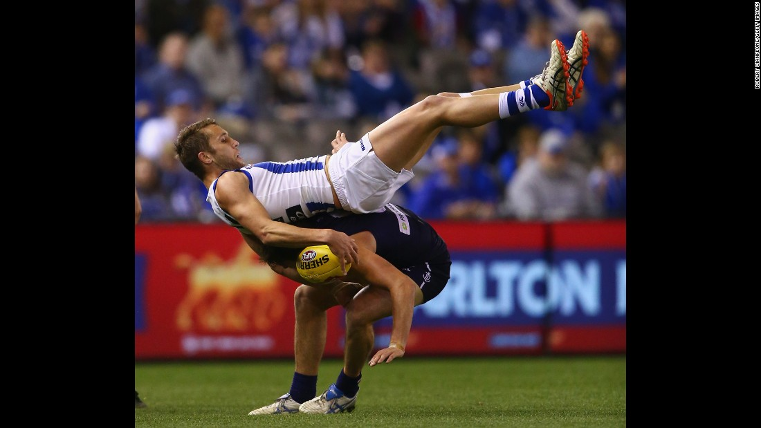 Jamie Macmillan of the North Melbourne Kangaroos marks over Nick Suban of the Fremantle Dockers during an Australian Football League match Sunday, August 23, in Melbourne.