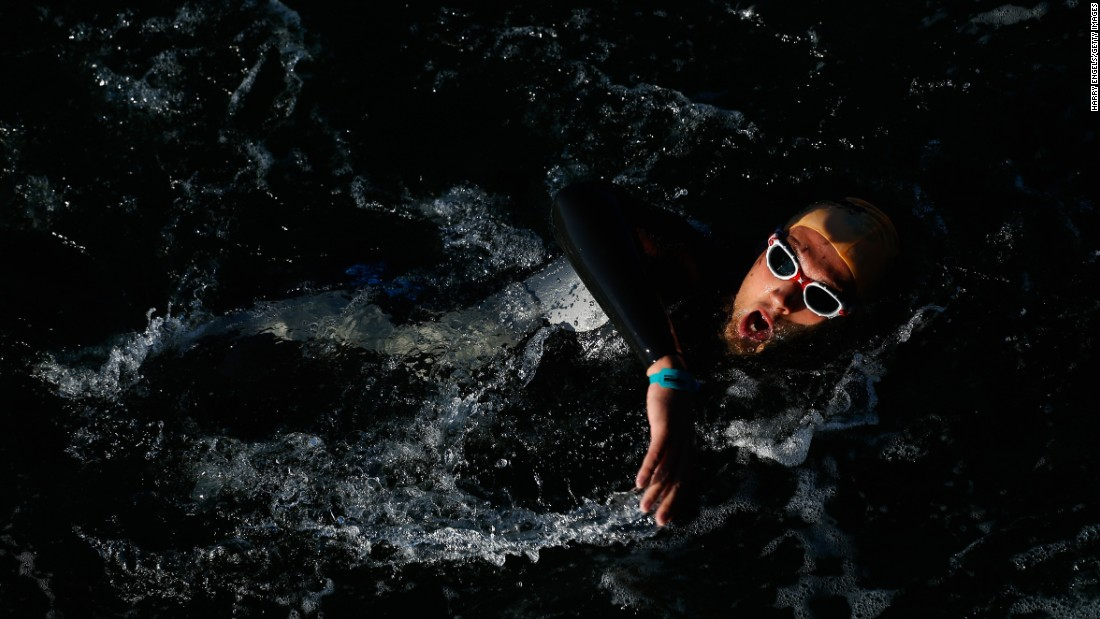 An athlete swims during an Ironman race in Copenhagen, Denmark, on Sunday, August 23.