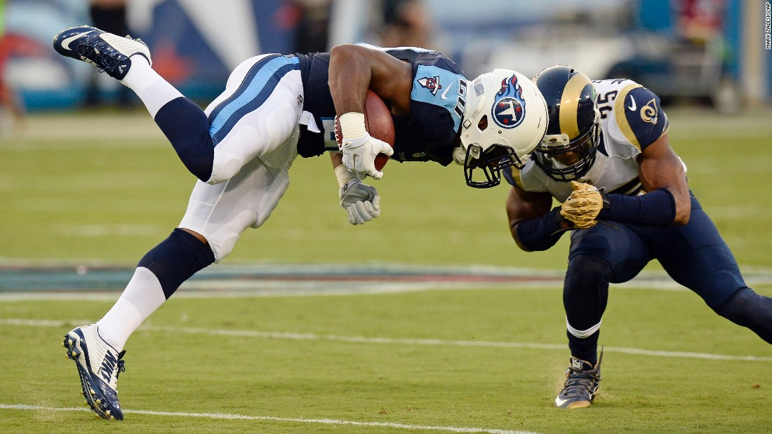 Tennessee Titans running back Bishop Sankey, left, collides with St. Louis safety T.J. McDonald during an NFL preseason game in Nashville, Tennessee, on Sunday, August 23.