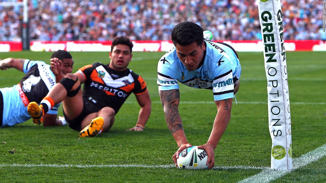 Sosaia Feki scores a try for the Cronulla Sharks during a National Rugby League match in Sydney on Saturday, August 22. Cronulla defeated the Wests Tigers 40-18.