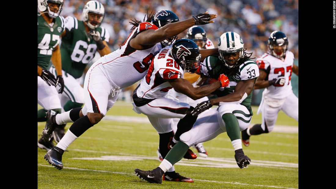 Phillip Adams of the Atlanta Falcons tackles Chris Ivory of the New York Jets during an NFL preseason game Friday, August 21, in East Rutherford, New Jersey.