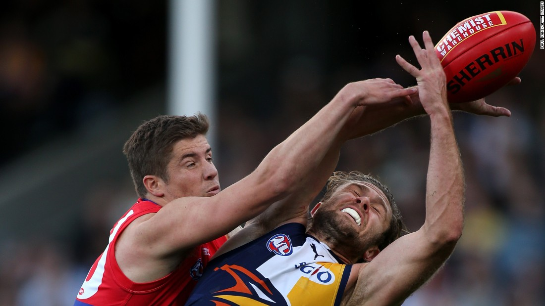 Daniel Pearce of the Western Bulldogs, left, spoils the mark for Mark Hutchings of the West Coast Eagles during an Australian Football League match in Perth on Sunday, August 23.