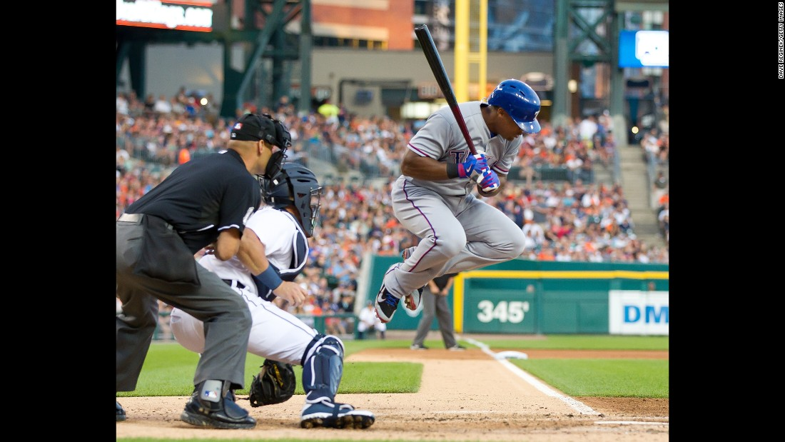 Texas' Adrian Beltre jumps out of the way of a wild pitch during a game in Detroit on Saturday, August 22.