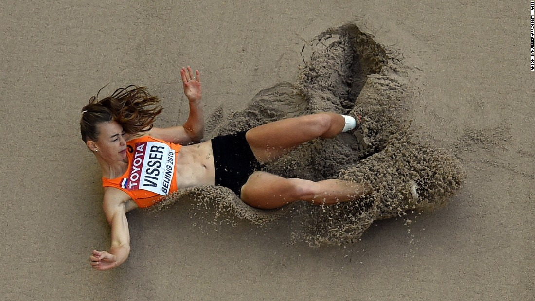 Dutch heptathlete Nadine Visser lands in the sand pit after a long-jump attempt Sunday, August 23, at the World Championships.