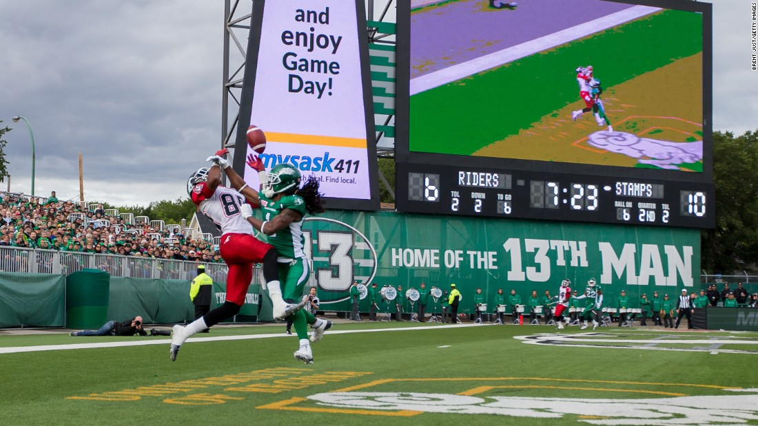 Saskatchewan's Marshay Green, right, breaks up a pass intended for Calgary's Eric Rogers during a CFL game in Regina, Saskatchewan, on Saturday, August 22. Green also intercepted the pass, which came on a two-point conversion attempt.