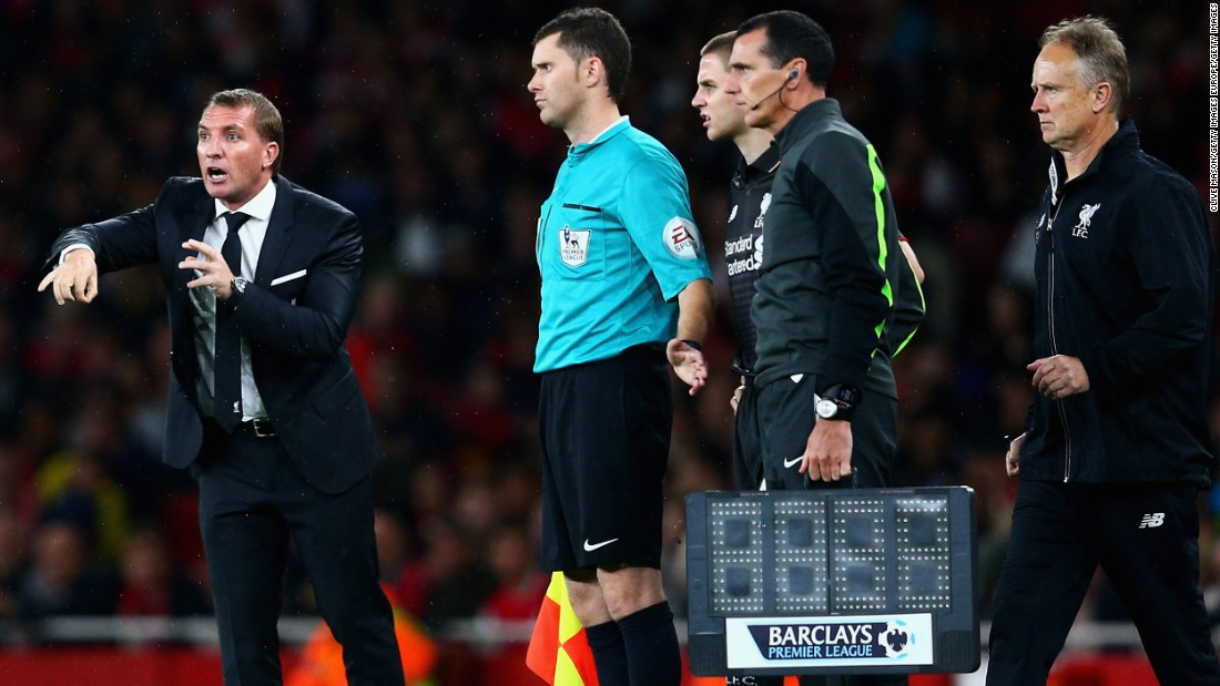 Liverpool manager Brendan Rodgers (left) gives instructions as he prepares to make a second-half substitution.