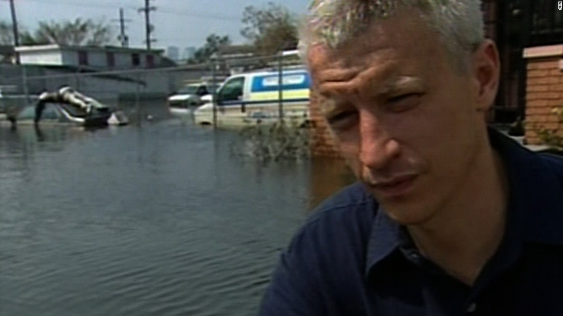 CNN's Anderson Cooper, covering Hurricane Katrina in New Orleans in 2005, reports on seeing a body on top of a car a week after the storm.
