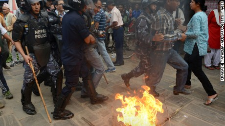 Nepalese police arrest supporters of opposition political parties during a protest against the draft constitution in Kathmandu on August 15, 2015.
