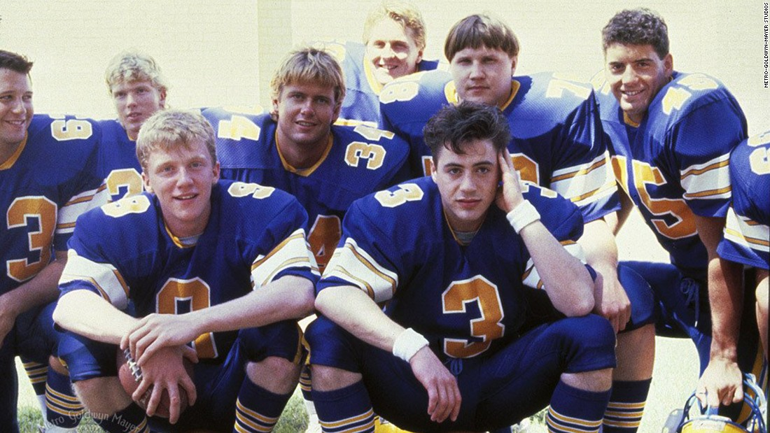"Anthony Michael Hall, front left, plays a star high school quarterback who agonizes over which college to pick in 1988's ""Johnny Be Good."" Yes, that's Robert Downey Jr. as his teammate."