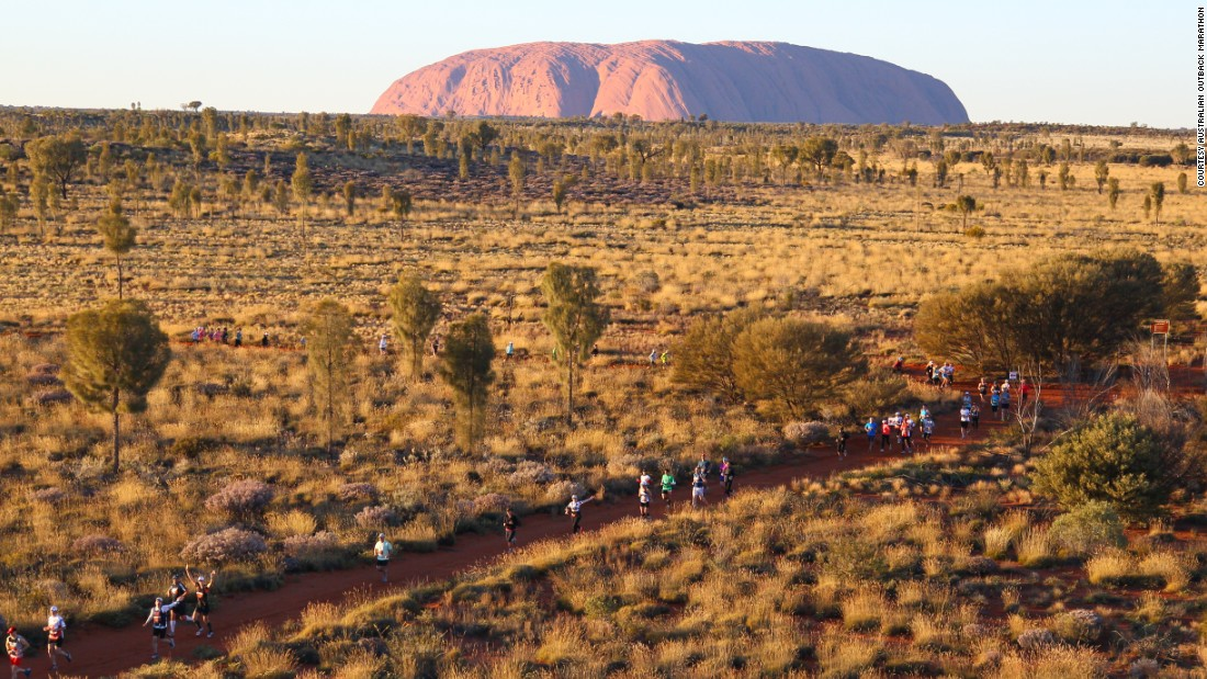 "Australia's magnificent monolith, Uluru, looms in the background as competitors race across the country's red center. The next edition of <a href=""http://australianoutbackmarathon.com/"" target=""_blank"">the marathon</a> will be held in July 2016."