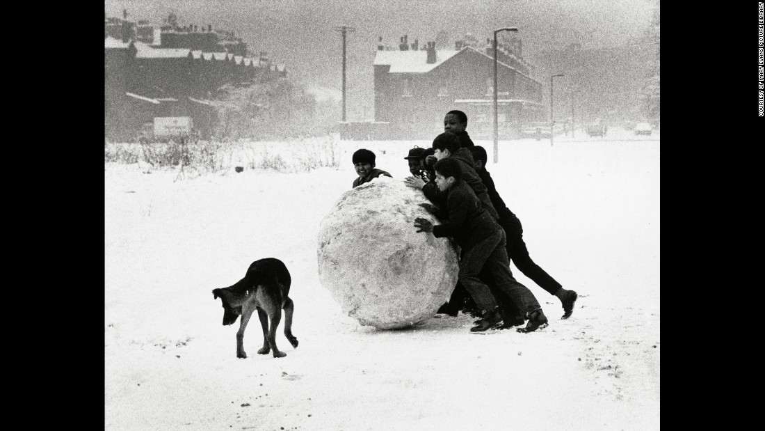 "The area, she added, had long been decrepit, but for its residents, it was home. ""They were used to it. The buildings were coal black and the water at the docks was like treacle. After the demolitions, all the moths changed color,"" she told The Guardian. Here, boys roll a snowball in 1968 Manchester."