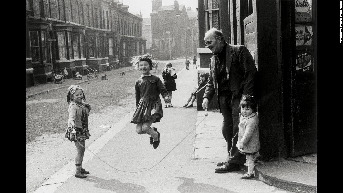 "Baker could find humor -- such as this 1968 Manchester photo of a man helping girls jump rope -- in apparent bleakness. ""Shirley had an eye beyond that of the pure recorder of fact; she had an uncanny ability to spot incidental humor in the scenes of everyday life which surrounded her,"" Tom Gillmor, head of content for the Mary Evans Picture Library -- where Baker's pictures are archived -- <a href=""http://www.bbc.com/news/in-pictures-29410300"" target=""_blank"">told the BBC after her death. </a>"