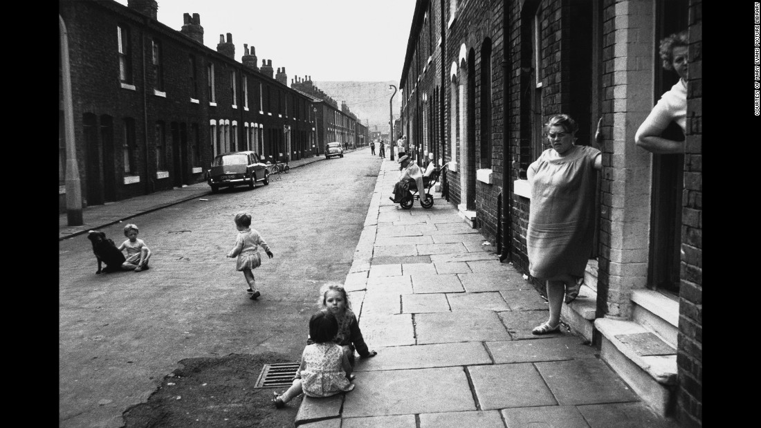 "The streets are both ghostly and lively. ""When Shirley Baker began photographing the streets of her native Salford, it seemed that no one was interested in recording the human story of these soon-to-be demolished communities,"" Gillmor told the BBC. ""That she chose to preserve these moments on film now seems like the only perceptive response to a vanishing environment."" This photo is of Manchester in 1966."