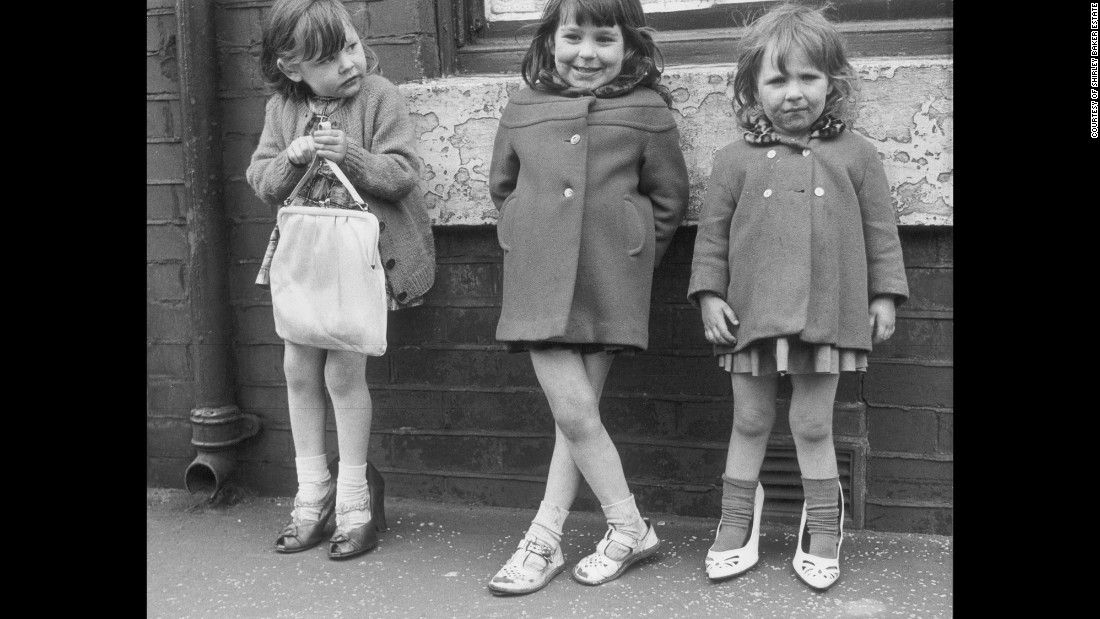 "These three girls were photographed in Manchester in 1965. ""What I was doing was about the people,"" Baker wrote for the Tate. ""I would go with an idea of perhaps taking pictures of textures, peeling paint, etc, but I always ended up photographing the people."""