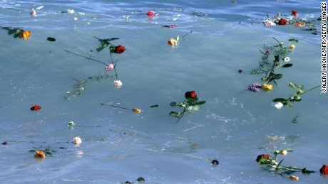 Flowers float in the Mediterranean Sea in honor of migrants lost while making the perilous journey to Europe.