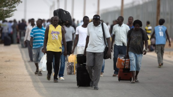 African migrants depart the Holot Detention Center in Israel