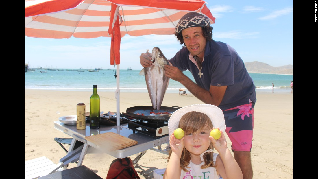 Catire makes dinner on the beach in Mancora, Peru. The family packed camping gear to make the long trip affordable.