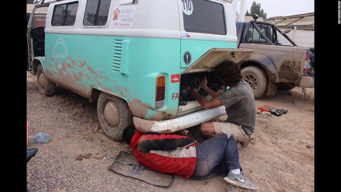 The Volkswagen bus was relatively cheap and certainly endearing, but it has had its problems. Catire has had to fix it several times. Here, Chilean friend Rafa helps with the engine in Copiapo after the devastating floods and mudslides.